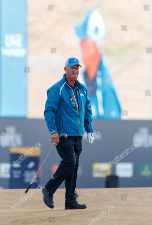 Sandy Lyle (SCO) walks past a giant screen on the first hole after playing the first tee shot of the 147th Open Championship at 06:35