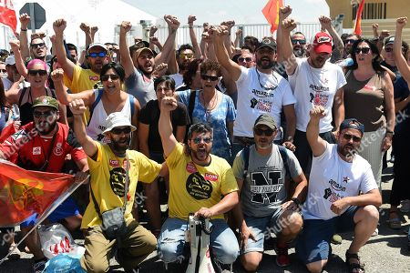 Several Amazon warehouse workers shout slogans during the second day of a three-day strike at Amazon logistic warehouse in San Fernando de Henares, Madrid, Spain, 18 July 2018.