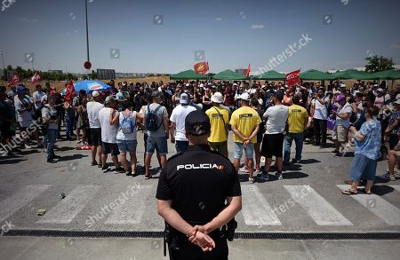 Several Amazon warehouse workers take part in the second day of a three-day strike at Amazon logistic warehouse in San Fernando de Henares, Madrid, Spain, 18 July 2018.