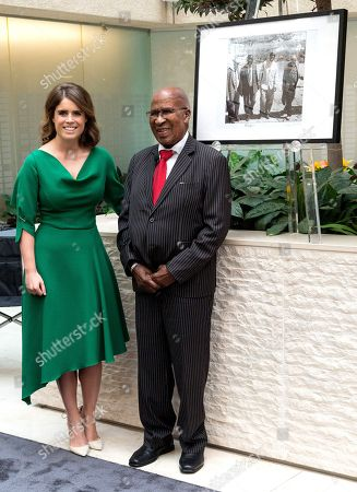 Princess Eugenie of York and anti-apartheid icon Andrew Mlangeni pose next to a photograph of him and Nelson Mandela revisiting Robben Island in 1994.