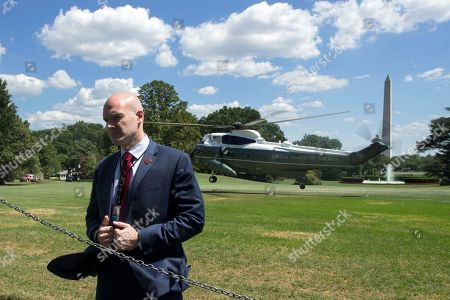 A US Secret Service agent stands on the South Lawn as Marine One arrives with US President Donald J. Trump and First Lady Melania Trump, at the White House in Washington, DC, USA, 18 July 2018. President Trump and the US First Lady return from Joint Base Andrews, Maryland, where they payed their respects to the family members of late US Secret Service Special Agent Nole Edward Remagen. Remagen died after suffering a stroke on the job during Trump's trip to Europe last week.