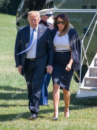 United States President Donald J. Trump and first lady Melania Trump holds hands as they arrive back at the White House in Washington, DC after a trip to Joint Base Andrews to pay their respects to the family of fallen United States Secret Service Special Agent Nole Edward Remagen who suffered a stroke while on duty in Scotland.