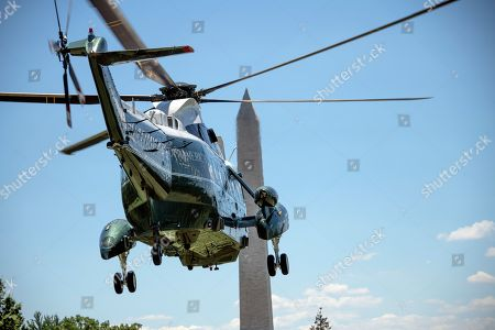 Stock Photo of Very hight resolution view of Marine One, with United States President Donald J. Trump and first lady Melania Trump aboard, departs the White House in Washington, DC en route to Joint Base Andrews where they will pay their respects to the family of fallen United States Secret Service Special Agent Nole Edward Remagen who suffered a stroke while on duty in Scotland.