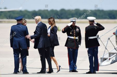 Donald Trump and First Lady Melania Trump arrive at Joint Airforce Base Andrews to pay their respects to the family of fallen United States Secret Service Special Agent Nole Edward Remagen who suffered a stroke while on duty in Scotland., in Maryland. Photo by Olivier Douliery/ Abaca Press