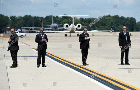 Secret Service agents stand still before U.S. President Donald Trump and First Lady Melania Trump arrive at Joint Airforce Base Andrews to pay their respects to the family of fallen United States Secret Service Special Agent Nole Edward Remagen who suffered a stroke while on duty in Scotland.
