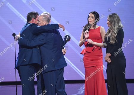 Jim Kelly, Camryn Kelly, Erin Kelly, John Elway, Dan Marino. Dan Marino, left, and John Elway, obscured, present the Jimmy V award for perseverance to Jim Kelly, with Camryn Kelly and Erin Kelly, right, watching, at the ESPY Awards at Microsoft Theater, in Los Angeles