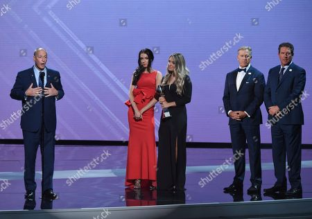 Jim Kelly, Camryn Kelly, Erin Kelly, John Elway, Dan Marino. Jim Kelly, left, accepts the Jimmy V award for perseverance with Camryn Kelly, from second left, Erin Kelly, John Elway, and Dan Marino at the ESPY Awards at the Microsoft Theater, in Los Angeles