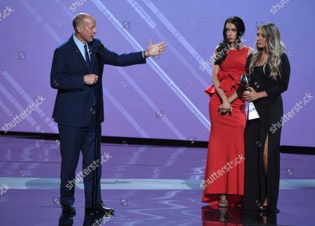 Jim Kelly, Camryn Kelly, Erin Kelly. Former NFL quarterback Jim Kelly, left, accepts the Jimmy V award for perseverance, next to Camryn Kelly, middle, and Erin Kelly, at the ESPY Awards at Microsoft Theater, in Los Angeles