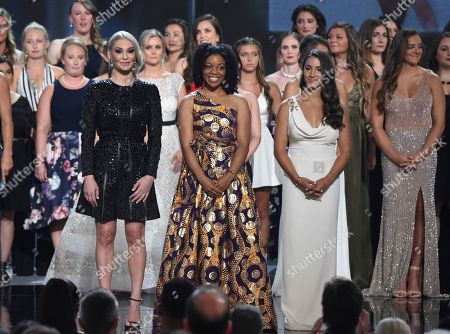 Sarah Klein, Tiffany Thomas Lopez, Aly Raisman. Former gymnast Sarah Klein, former Michigan State softball player Tiffany Thomas Lopez and gymnast Aly Raisman, from left in front, and others who suffered sexual abuse accept the Arthur Ashe award for courage at the ESPY Awards at the Microsoft Theater, in Los Angeles