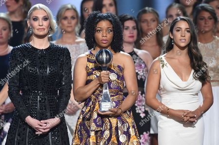 Sarah Klein, Tiffany Thomas Lopez, Aly Raisman. Sarah Klein, from left, former Michigan State University softball player Tiffany Thomas Lopez and gymnast Aly Raisman accept the Arthur Ashe award for courage at the ESPY Awards at the Microsoft Theater, in Los Angeles