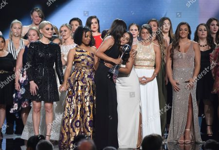 Sarah Klein, Tiffany Thomas Lopez, Aly Raisman, Jennifer Garner. Jennifer Garner, front, embraces gymnast Aly Raisman after presenting the Arthur Ashe Award for Courage, at the ESPY Awards at Microsoft Theater, in Los Angeles. Holding hands in front left are former gymnast Sarah Klein and former Michigan State softball player Tiffany Thomas Lopez. More than 140 survivors of sexual abuse by a former team doctor for USA Gymnastics and Michigan State University joined hands on stage to be honored with the award