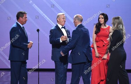 Jim Kelly, Camryn Kelly, Erin Kelly, John Elway, Dan Marino. Dan Marino, left, and John Elway present the Jimmy V award for perseverance to Jim Kelly, center, with Camryn Kelly and Erin Kelly, right, nearby at the ESPY Awards at Microsoft Theater, in Los Angeles