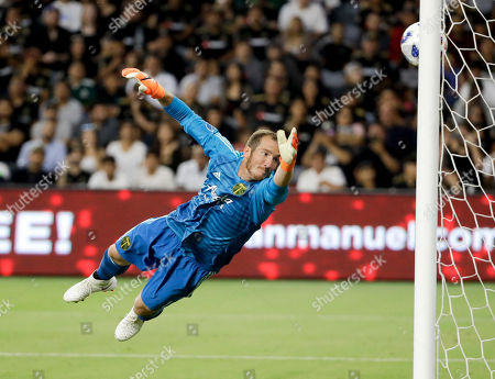 Stock Picture of Portland Timbers goalkeeper Jeff Attinella fails to stop a gaol by Los Angeles FC forward Marco Urena during the first half of an MLS soccer match in Los Angeles