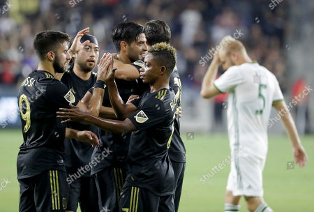 Los Angeles FC players celebrate a goal by forward Marco Urena against the Portland Timbers during the first half of an MLS soccer match in Los Angeles
