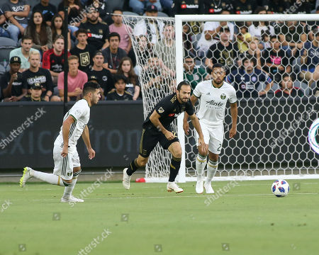 Los Angeles, CA...Los Angeles FC forward Marco Urena #21 going after a ball during the Los Angeles Football Club vs Portland Timbers at BANC OF CALIFORNIA Stadium in Los Angeles, Ca on , 2018. Jevone Moore