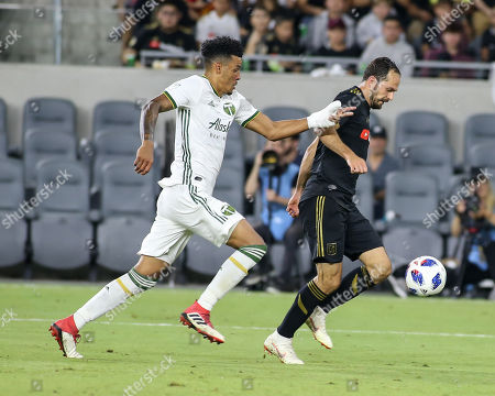 Los Angeles, CA...Los Angeles FC forward Marco Urena #21during the Los Angeles Football Club vs Portland Timbers at BANC OF CALIFORNIA Stadium in Los Angeles, Ca on , 2018. Jevone Moore