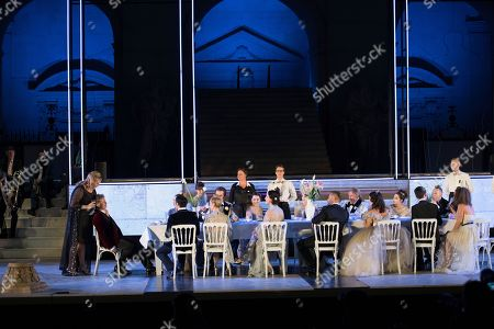 Stock Photo of Stefanie  Reinsperger as Buhlschaft (L) and Tobias Moretti as Jedermann perform on stage during a rehearsal of Hugo von Hofmannsthal's Jedermann (Everyman) at the Domplatz square in Salzburg, Austria, 18 July 2018 (issued 19 July 2018). The play Jedermann, one of the highlights of the Salzburg festival, which was established in 1920, runs from 20 July to 30 August 2018.