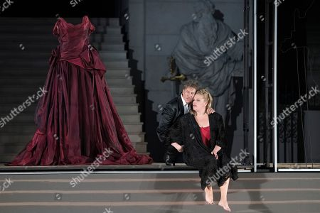 Tobias Moretti as Jedermann (L) and Stefanie  Reinsperger as Buhlschaft perform on stage during a rehearsal of Hugo von Hofmannsthal's Jedermann (Everyman) at the Domplatz square in Salzburg, Austria, 18 July 2018 (issued 19 July 2018). The play Jedermann, one of the highlights of the Salzburg festival, which was established in 1920, runs from 20 July to 30 August 2018.