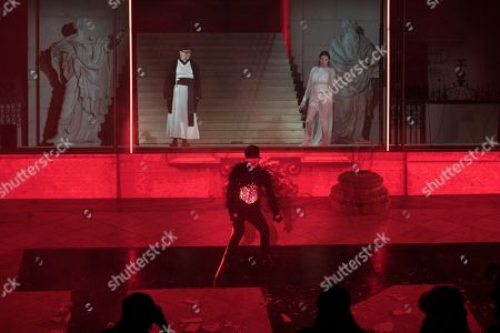 Johannes Silberschneider as 'Glaube' (faith, L), Mavie Hoerbiger as 'Werke' (works, R) Hanno Koffler as 'Teufel' (devil) perform on stage during a rehearsal of Hugo von Hofmannsthal's Jedermann (Everyman) at the Domplatz square in Salzburg, Austria, 18 July 2018 (issued 19 July 2018). The play Jedermann, one of the highlights of the Salzburg festival, which was established in 1920, runs from 20 July to 30 August 2018.
