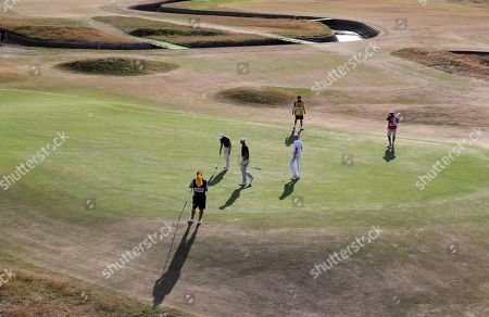 Jens Dantorp of Sweden, Kyle Stanley of the US and Nicolas Colsaerts of Belgium on hole 17 during the first round of the British Open Golf Championship in Carnoustie, Scotland