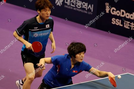 Cha Hyo-sim of North Korea (R) and Jang Woo-jin of South Korea in action during their mixed doubles match against Kit Kwan Ho and Ching Ho Lee of Hongkong at the International Table Tennis Federation (ITTF) World Tour Platinum Korean Open in Daejeon, 160 kilometers south of Seoul, South Korea, 19 July 2018.