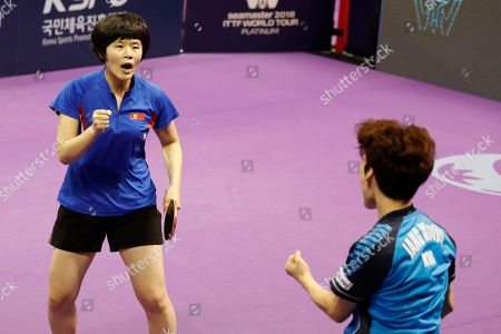 Stock Picture of Cha Hyo-sim of North Korea (L) and Jang Woo-jin of South Korea react during their mixed doubles match against Kit Kwan Ho and Ching Ho Lee of Hongkong at the International Table Tennis Federation (ITTF) World Tour Platinum Korean Open in Daejeon, 160 kilometers south of Seoul, South Korea, 19 July 2018.