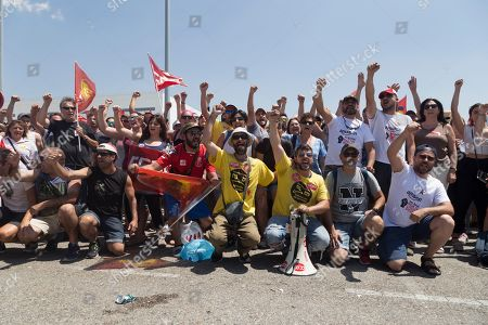 Protesters are seen posing for the camera while celebrating their strike.