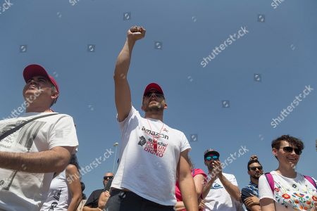 Stock Picture of A man is seen with his fist raised during the protest.