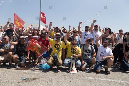 Stock Image of Protesters are seen posing for the camera while celebrating their strike.