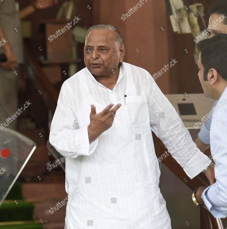 Samajwadi party leader Mulayam Singh Yadav arrives at the Parliament house on the first day of the Monsoon session