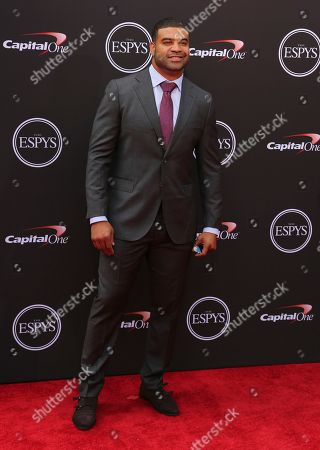 Former NFL football player Shawne Merriman arrives at the ESPY Awards at the Microsoft Theater, in Los Angeles