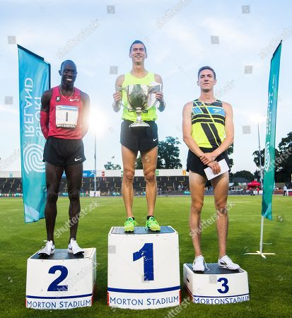 USA's Sam Prakel, Lopez Lomong and Henry Wynne after placing in the Morton Mile
