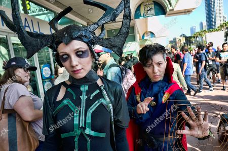 Stock Photo of Tanya Dibrova, left, dressed as Marvel Comics character Hela, and Liz Torres, dressed as Doctor Strange arrive for Comic-Con International, in San Diego