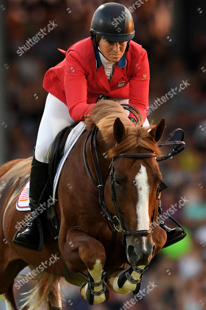 Elizabeth Madden of the United States of America on 'Darry Lou' compete in the Mercedes-Benz Nations Cup show jumping event at the CHIO in Aachen, Germany 19 July 2018.