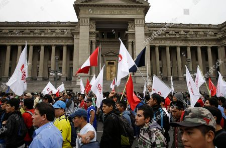 Demonstrators protest corruption outside the Supreme Court in Lima, Peru, . The latest scandal to embroil this South American nation has ensnared some of the country's highest-ranking judges and political officials and comes just four months after then-President Pedro Pablo Kuczynski stepped down in a separate corruption probe