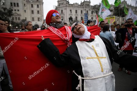 Actors perform during a protest against corruption at San Martin plaza, in Lima, Peru, . The latest scandal to embroil this South American nation has ensnared some of the country's highest-ranking judges and political officials and comes just four months after then-President Pedro Pablo Kuczynski stepped down in a separate corruption probe