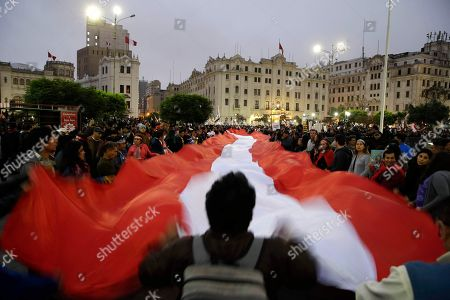 Demonstrators protest against corruption at San Martin plaza, in Lima, Peru, . The latest scandal to embroil this South American nation has ensnared some of the country's highest-ranking judges and political officials and comes just four months after then-President Pedro Pablo Kuczynski stepped down in a separate corruption probe
