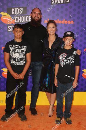 WWE wrestler Ronda Rousey, mixed martial artist Travis Browne and Kids