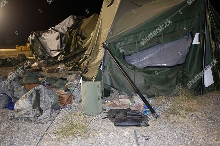 Stock Picture of This photo provided by the U.S. Army shows a tent that was blown down by a helicopter injuring 22 people at the Fort Hunter Liggett military base in California on . A U.S. Army UH-60 Blackhawk helicopter was landing about 9:30 p.m. when the wind from its rotor caused the tent to collapse, said Amy Phillips, public information officer at the Monterey County base