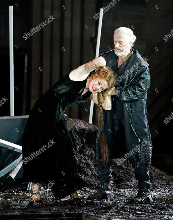 Stock Photo of Linn Reusse (L) as Swanhild daughter von Siegfried und Kriemhild and Juergen Prochnow as Hunnenkoenig, perform on stage during a photo rehearsal of 'Siegfrieds Erben' for the Nibelungen Festival Worms, in Worms, Germany, 19 July 2018.  The festival features the old Norse and Germanic mythology saga of the 'Nibelungen' about the life and love, treason and tragedy of the Burgundians royal family and their legendary treasure in Worms in the fifth century. This year's festival titled 'Siegfrieds Erben' and will held on a open-air stage in front of Worms Cathedral from 20 July to 5 August 2018.