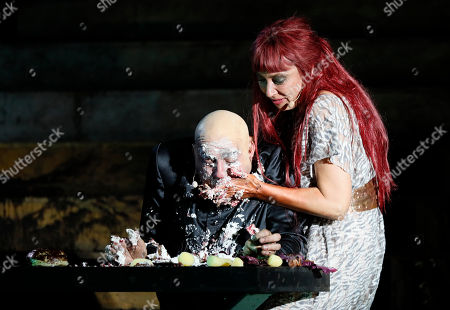 Stock Photo of Actors Ursula Strauss (R) as Burgherrin Brunhild and Miguel Abrantes Ostrowski as Priester perform on stage during a photo rehearsal of 'Siegfrieds Erben' for the Nibelungen Festival Worms, in Worms, Germany, 19 July 2018. The festival features the old Norse and Germanic mythology saga of the 'Nibelungen' about the life and love, treason and tragedy of the Burgundians royal family and their legendary treasure in Worms in the fifth century. This year's festival titled 'Siegfrieds Erben' and will held on a open-air stage in front of Worms Cathedral from 20 July to 5 August 2018.