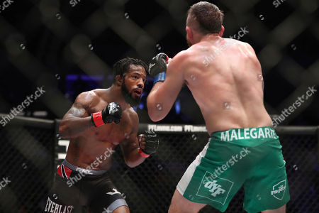 Stock Image of Josh Copeland,Shawn Jordan,Andre Harrison,Bas Rutten. Andre Harrison, left, in action against Nazareno Malegarie during their mixed martial arts bout at PFL 4, at Nassau Coliseum in New York. Harrison won via unanimous decision