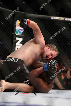 Josh Copeland,Shawn Jordan,Andre Harrison,Bas Rutten. Jared Rosholt, top, lands punches against Kelvin Tiller during their mixed martial arts bout at PFL 4, at Nassau Coliseum in New York. Tiller won via 2nd round submission