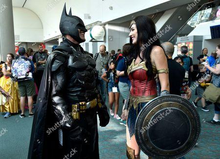 Armando Abarca, Jessica Rose Davis. Armando Abarca, left, dressed as Batman, and Jessica Rose Davis, dressed as Wonder Woman, of Los Angeles, attend day one of Comic-Con International, in San Diego