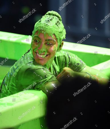 Candace Parker is slimed following the slime dunk challenge at the Kids' Choice Sports Awards at the Barker Hangar, in Santa Monica, Calif