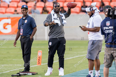 Former NFL quarterback Michael Vick tosses a ball around on the sideline prior to the American Flag Football League Ultimate Final between Godspeed and Fighting Cancer at BBVA Compass Stadium in Houston, TX. Fighting Cancer won the game 26 to 6