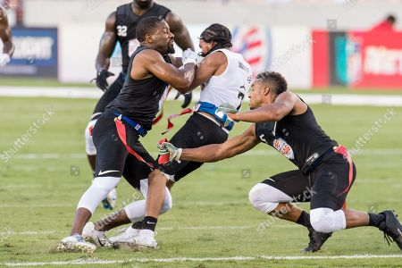 Godspeed defensive back Josh Wilson (26) draws a penalty for smashing into Fighting Cancer quarterback Darrell Doucette (7) during the American Flag Football League Ultimate Final between Godspeed and Fighting Cancer at BBVA Compass Stadium in Houston, TX. Fighting Cancer won the game 26 to 6