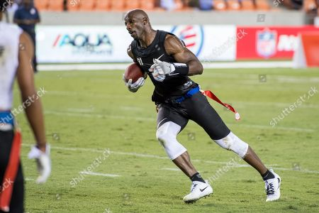 Stock Image of Godspeed wide receiver Jason Avant (81) runs for a touchdown during the American Flag Football League Ultimate Final between Godspeed and Fighting Cancer at BBVA Compass Stadium in Houston, TX. Fighting Cancer won the game 26 to 6