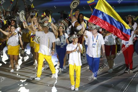 The delegation of Colombia parades during the 23rd Central American and Caribbean Games, in Barranquilla, Colombia, 19 July 2018. The inauguration ceremony, which features Colombian international star Shakira as the main artist, began with the appearance of the former Miss Universe and Colombian model Paulina Vega in the center of the stadium at the Roberto Melendez Metropolitan Stadium in Barranquilla.
