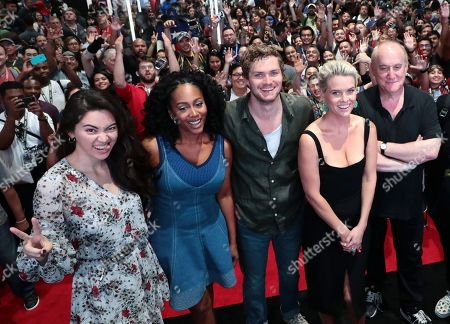 "Jessica Henwick, Simone Missick, Finn Jones, Alice Eve, Jeph Loeb, Executive Producer, Head of Marvel Television, Raven Metzner, Executive Producer, and Clayton Barber, Stunt Coordinator, from ""Marvel's Iron Fist"" at a fan signing at San Diego Comic-Con 2018."